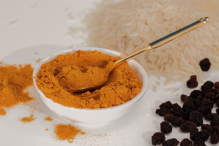 Turmeric powder comes from grounding the root of a plant that grows abundantly in India