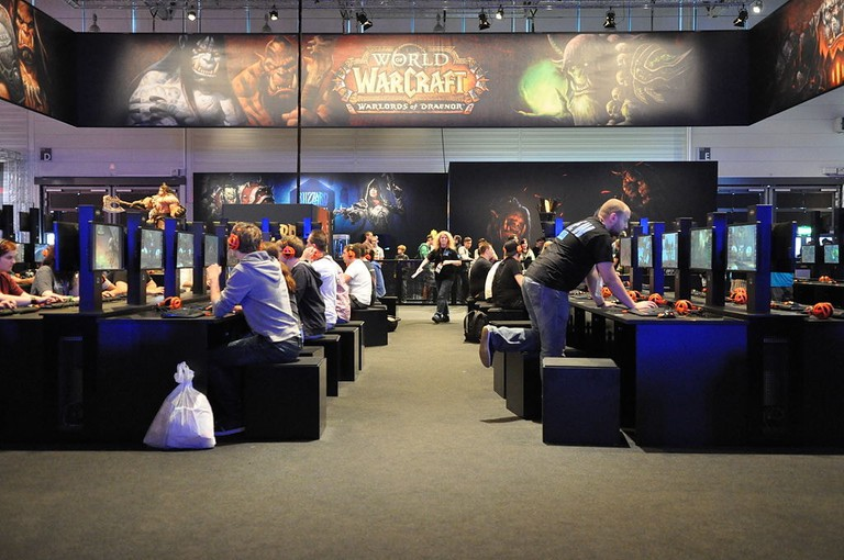People playing World of Warcraft at the Gamescom festival