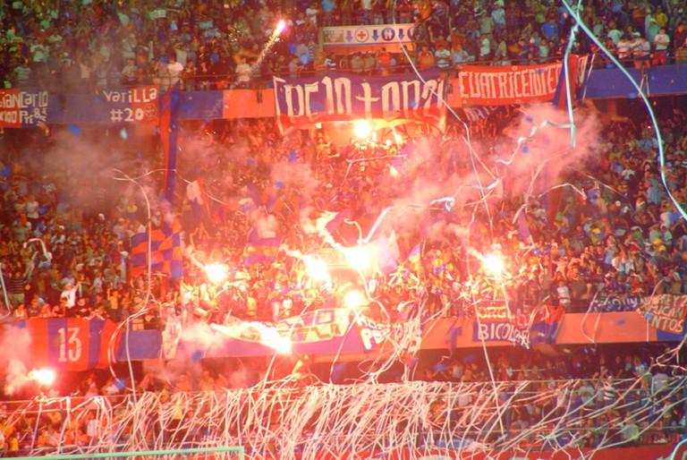 The football hooligans, or barra brava