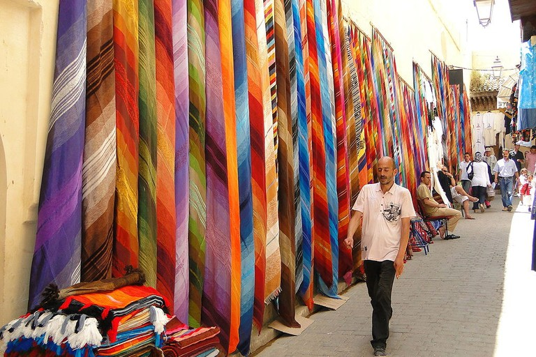 Colorful cloth for sale in Medina ©Adam Jones PhD/WikiCommons