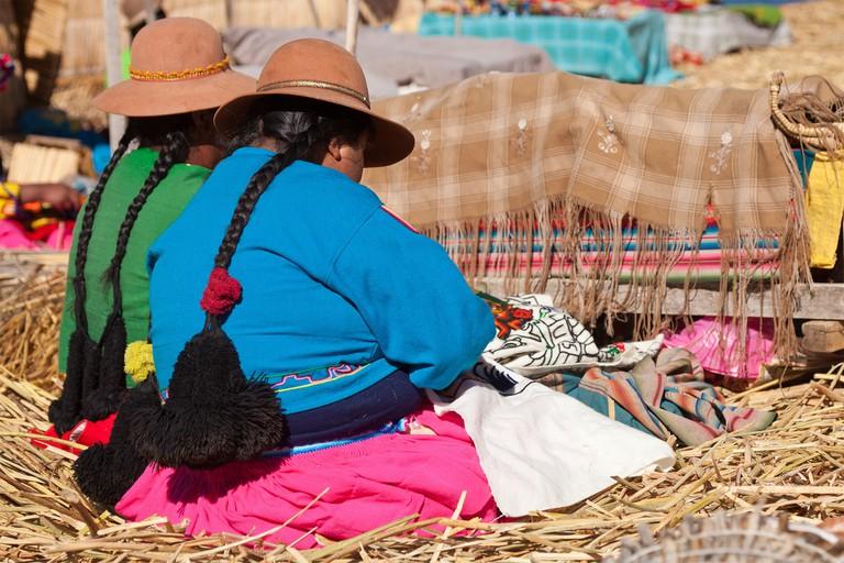 Working women on the floating islands on Lake Titicaca, Peru
