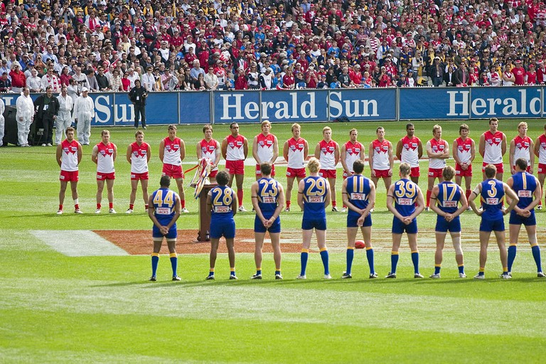 The teams line up for the national anthem, 2005 AFL Grand Final