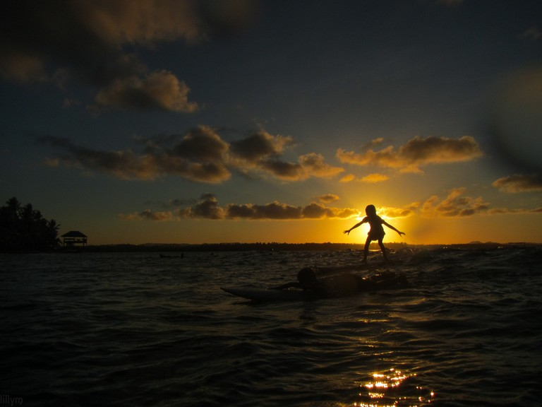 Surfing at sunset, Siargao