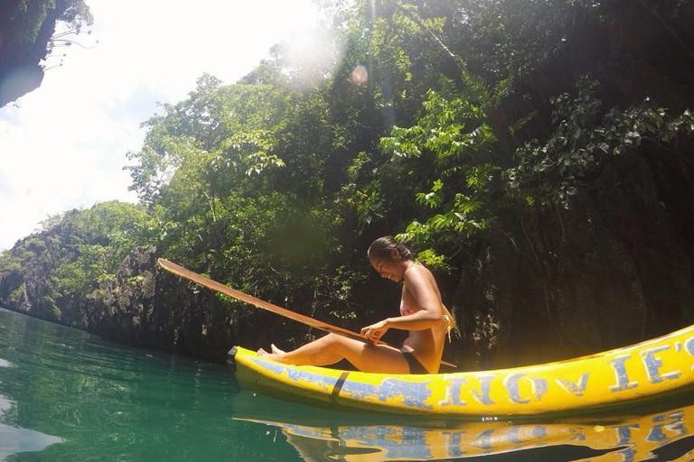 Writer kayaking in El Nido, Palawan