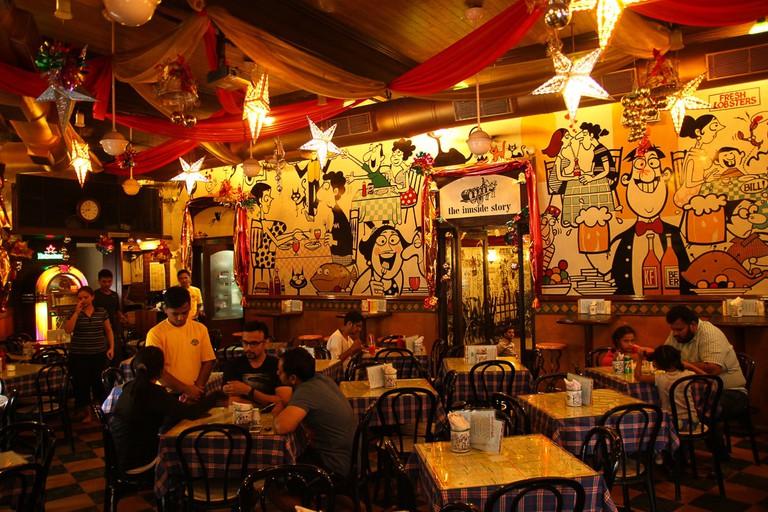 Legendary cartoonist Mario Miranda's mural art fills the cafe's walls