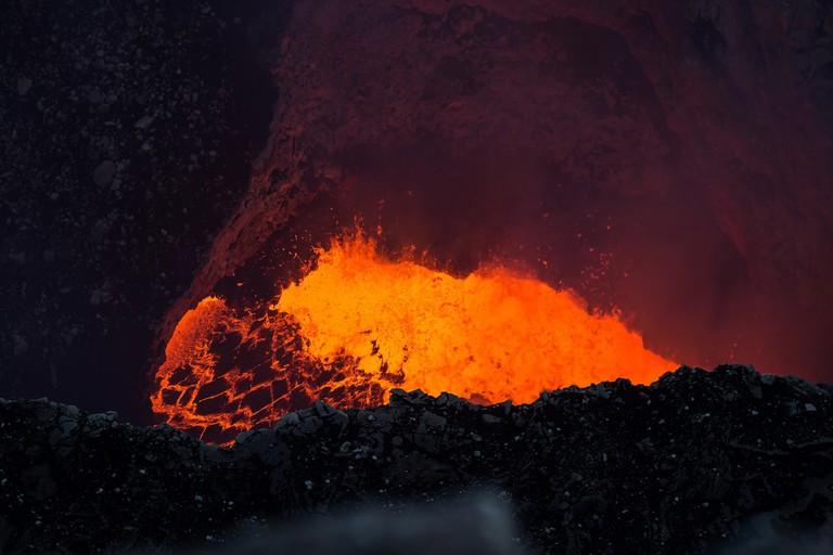Lava lake glows red at Masaya volcano