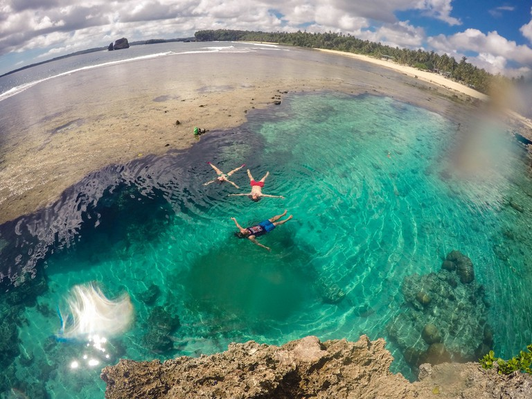 Floating in the calm sea, Siargao
