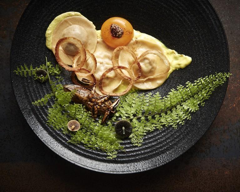 Crab and giant water beetle ravioli, turmeric saffron sauce