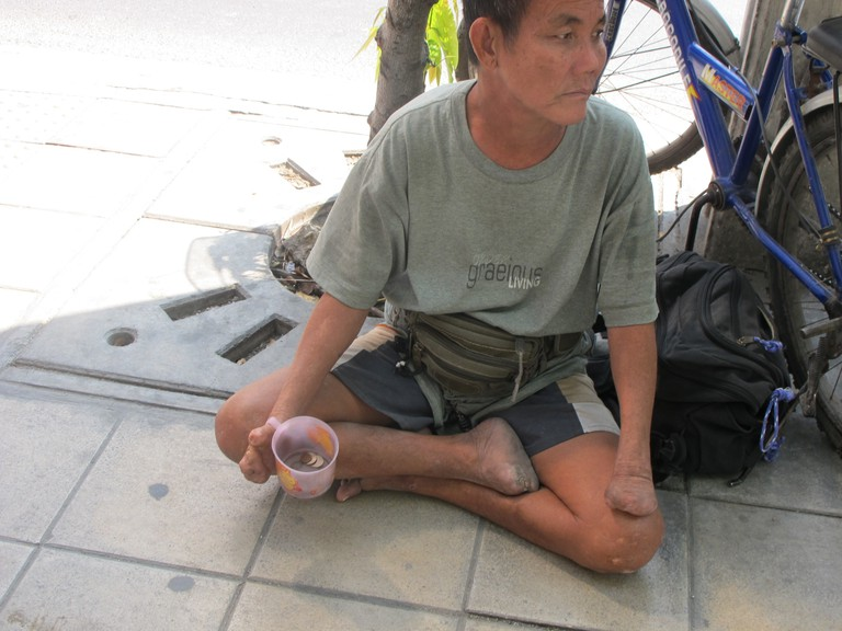 A local beggar in Bangkok