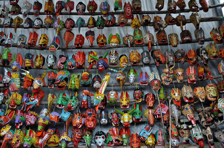 Wooden masks in Nim Pot, Antigua Guatemala