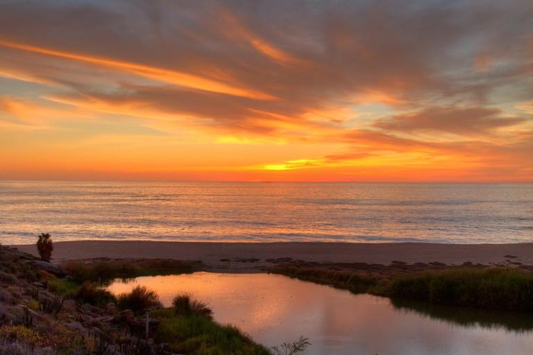 The sun setting over the lagoon in Todos Santos