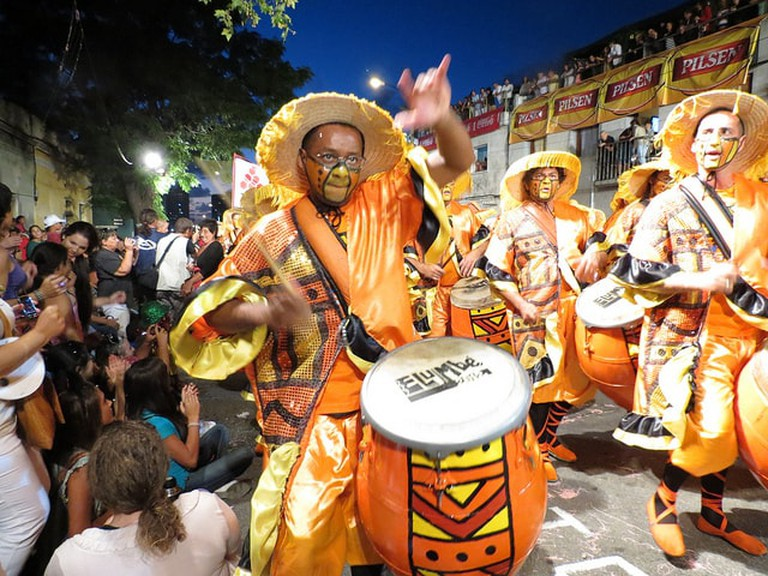 Man playing the drums at a comparsa, Uruguay