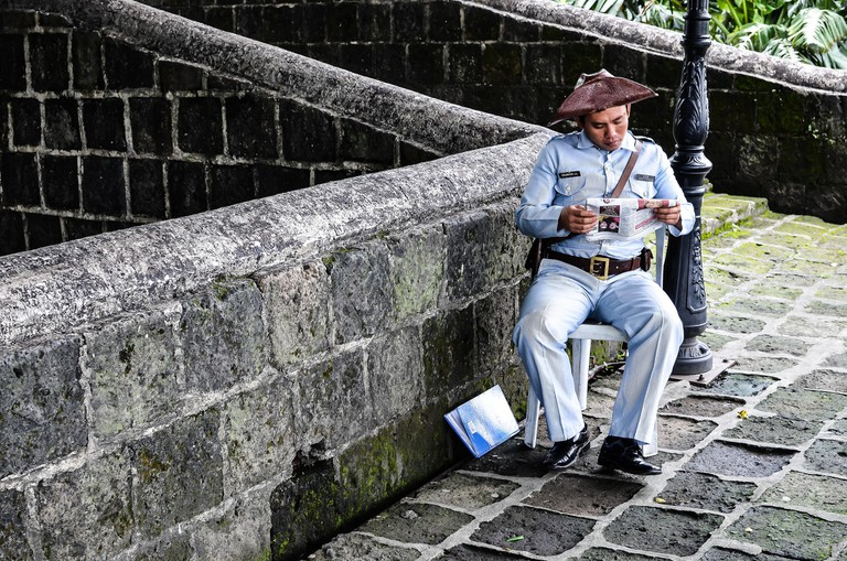 Guard reading in Intramuros