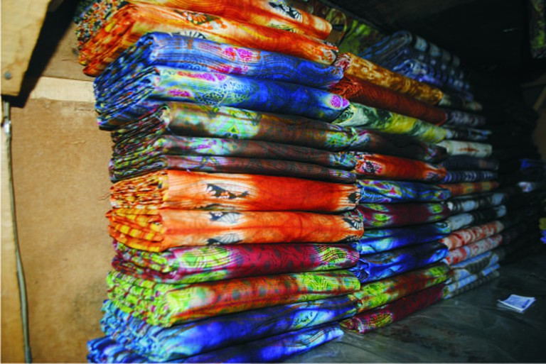Purchase Adire fabric from the local markets