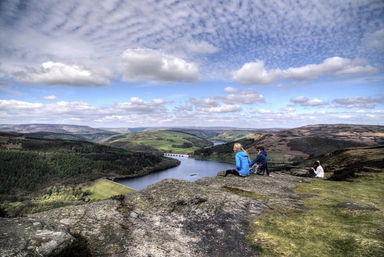 Sitting on Bamford Edge looking over the Dark Peak area, Peak District