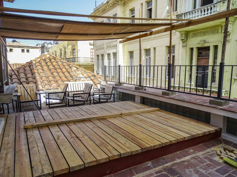 Restored outdoor area in a historical structure in Old Havana | © Amber C. Snider