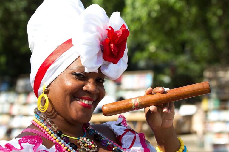 Cuban woman poses with cigar
