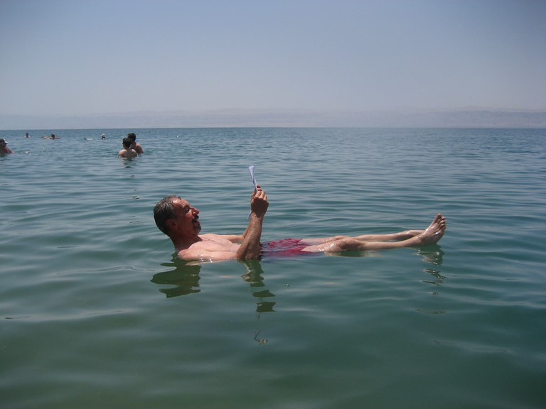 Dead Sea, man reading