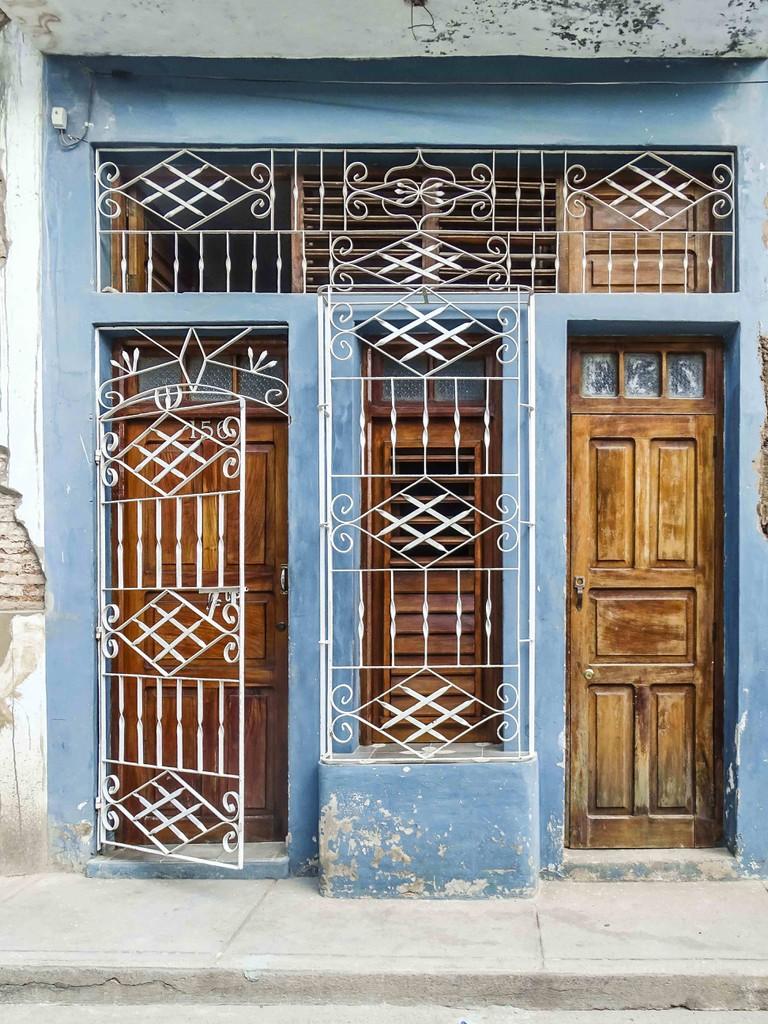 Intricate metal work on window gates in Cuba