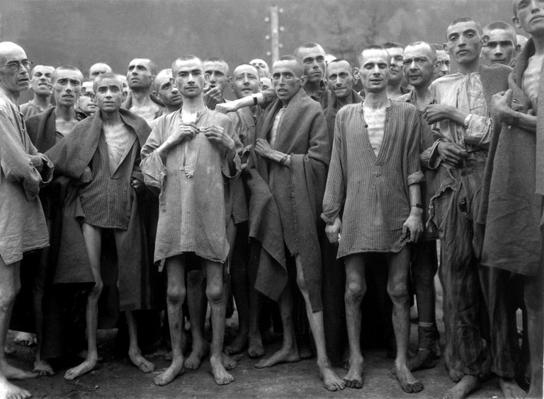 Starved prisoners, nearly dead from hunger, pose in a concentration camp in Ebensee, Austria