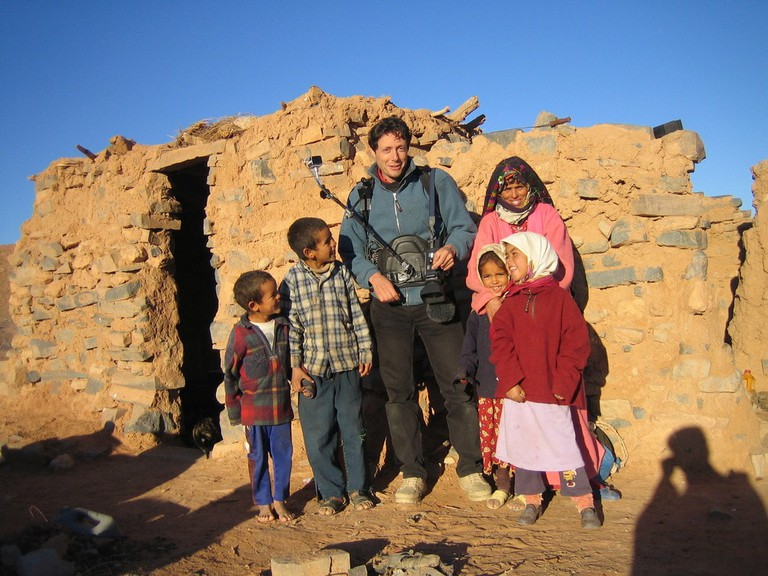 With a family of nomads in the desert near Merzouga, Morocco