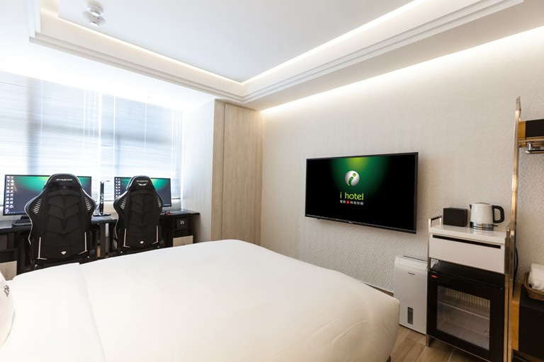 A comfy bed and a huge TV