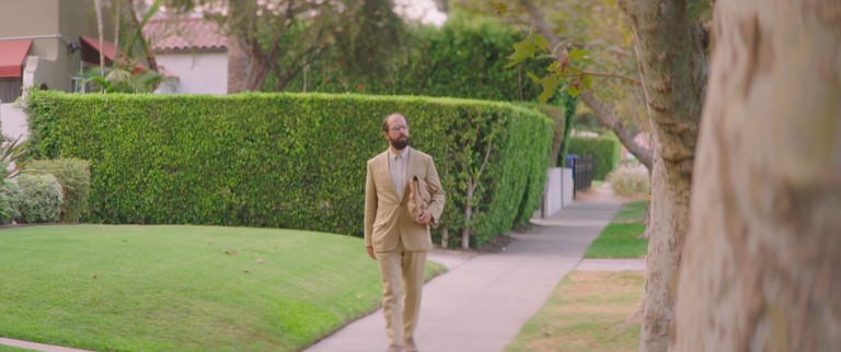 Isaac (Brett Gelman) heading to a date with Cleo