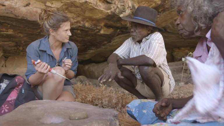 Elspeth Hayes with Mark Djandjomerr and traditional owner May Nango extracting comparative samples at a cave adjacent Madjedbebe Courtesy of