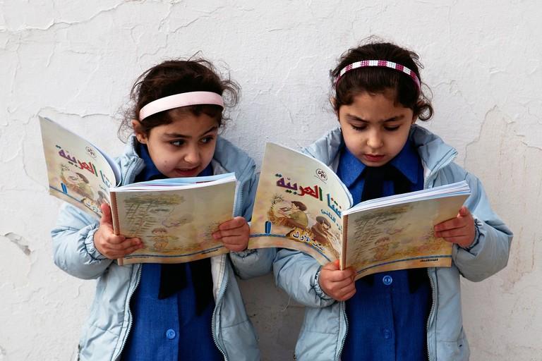 Kids reading in Jordan