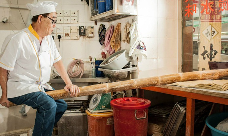 "Mr. Lee, proprietor of Kwan Kee in Cheung Sha Wan, is one of the last remaining locals in Hong Kong that keeps the age-old art of jook sing ""bamboo"" noodle-making alive. Photo: Courtesy of Kwan Kee."