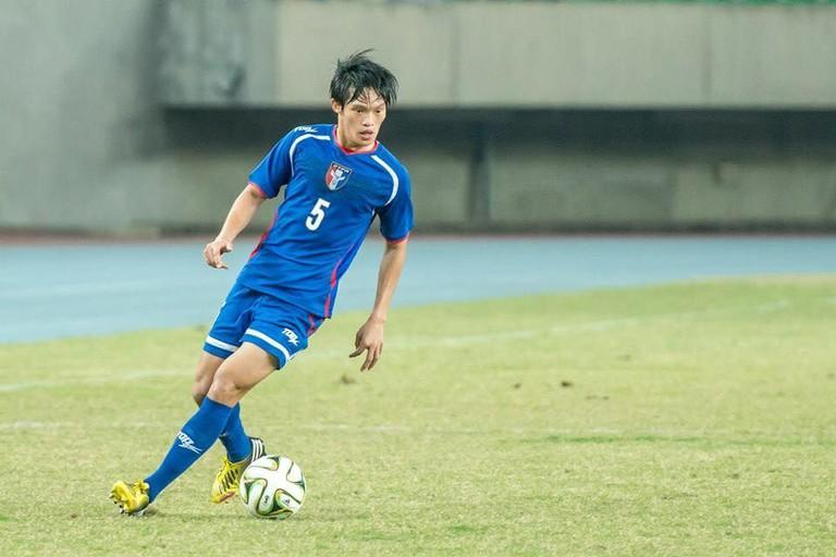 Player Lin Yueh Han controls the ball