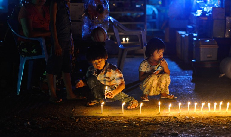 Myanmar children light candles to celebrate Thadingyut