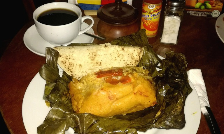 A traditional Nicaraguan nacatamal and coffee