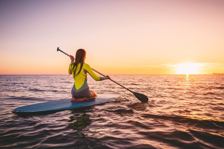 Paddleboarding in the ocean