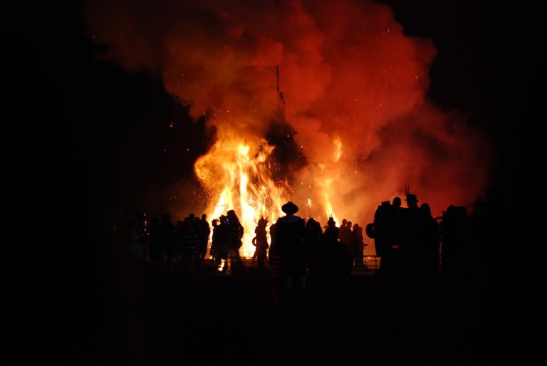 People gather around a bonfire on Guy Fawkes Night