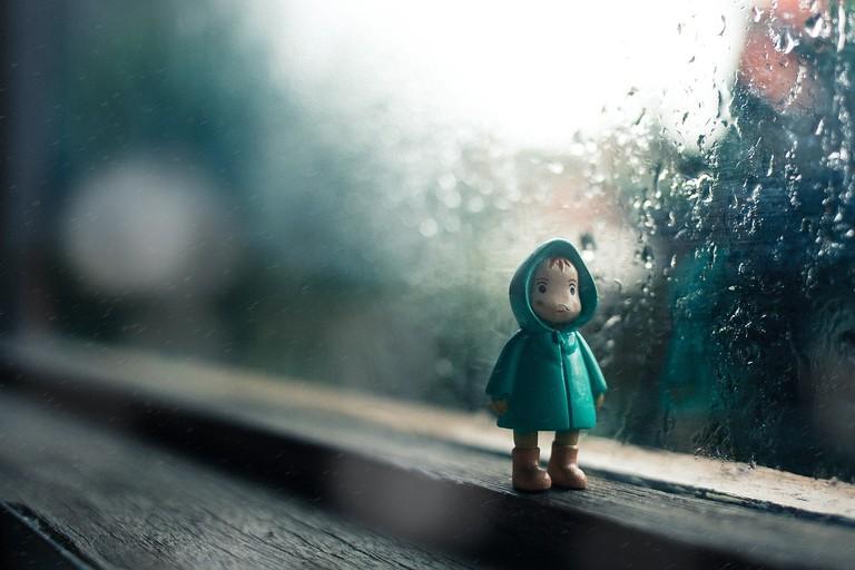 Toy with rain jacket