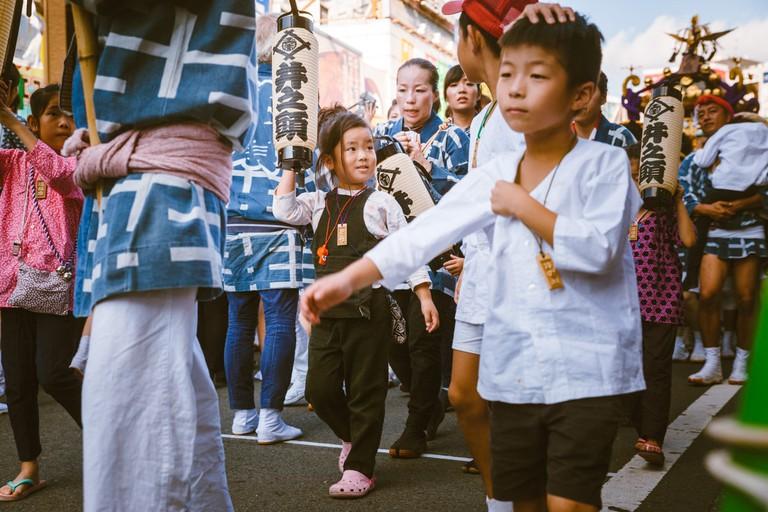 Children and parents attending Kichijoji festival | Mithila Jariwala / © Culture Trip