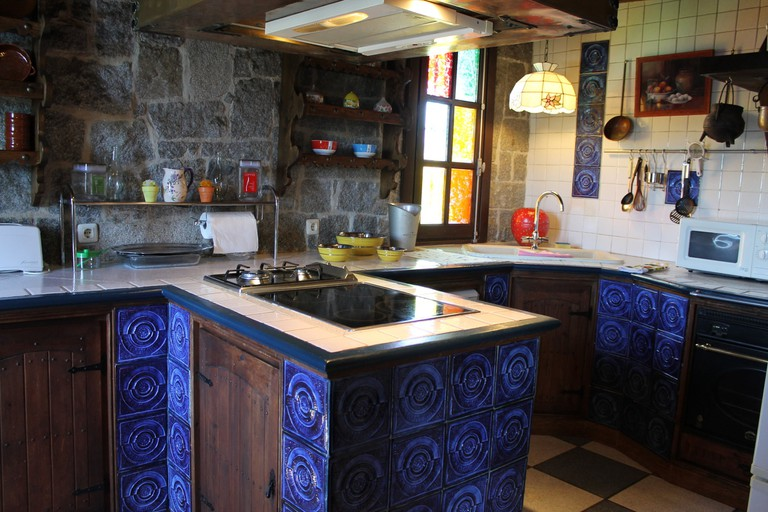 The blue tiles are 200 years old and came from a house in Portugal; courtesy of Aida estate agency