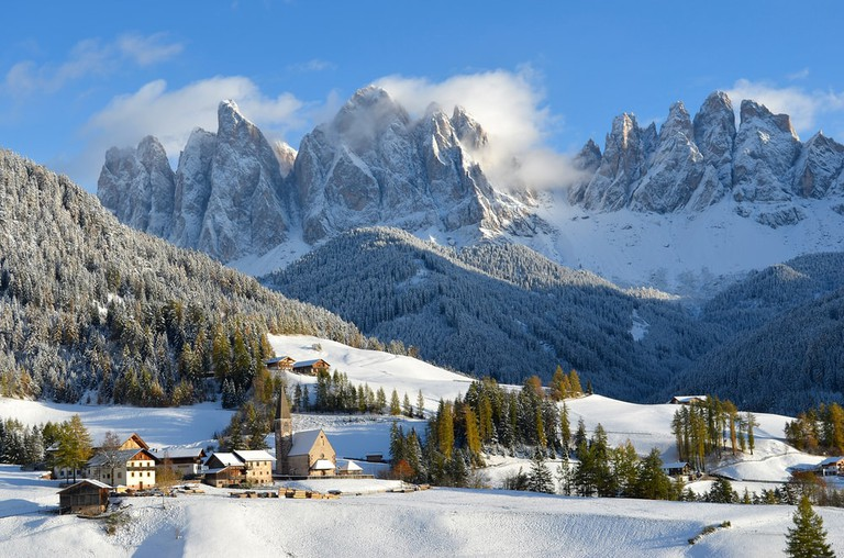 St. Magdalena in front of the Odle dolomites, Italy   © iPics/Shutterstock