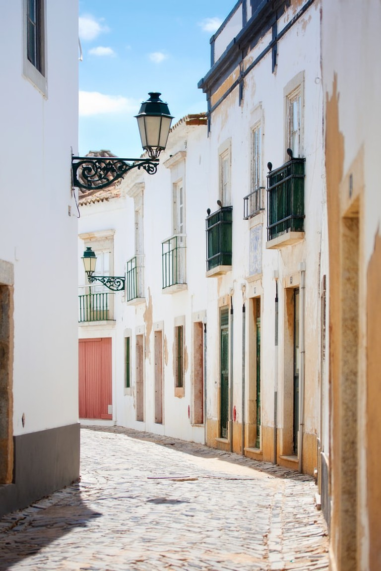 A Street in Faro Old Town, Algarve, Portugal   © aniad/Shutterstock