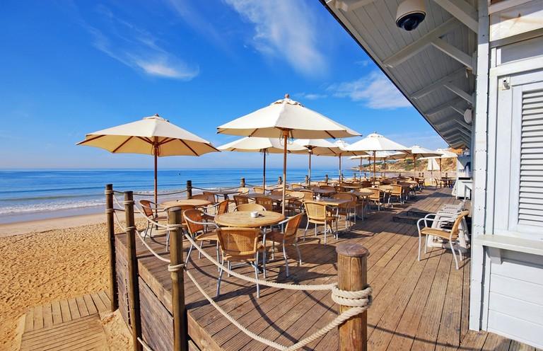A beach cafe along the Algarve coast, Portgual   © InnaFelker/Shutterstock