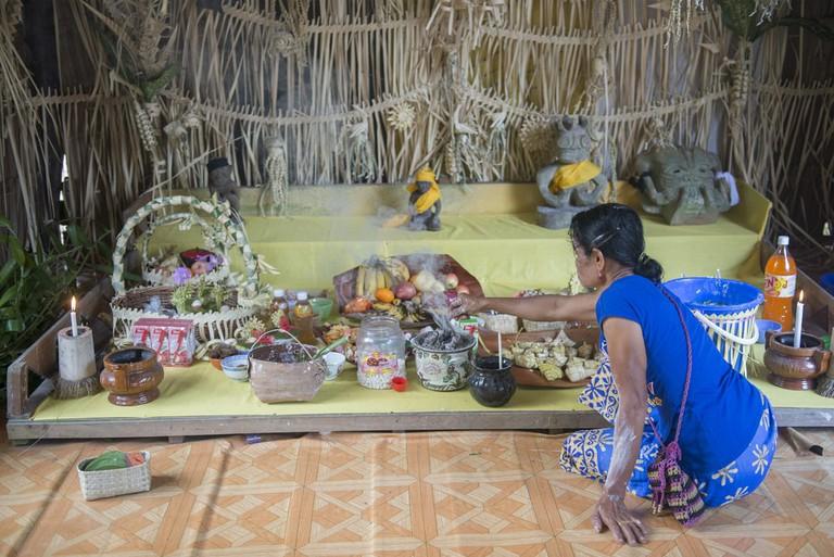 A member of Malaysia's Mah Meri tribe participates in a Ari Muyang ritual | © idome/Shutterstock