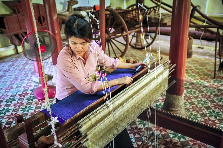A silk weaver in Phnom Penh