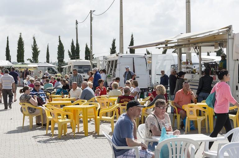 Visitors enjoying food at Loule market in the Algarve, Portugal   © travelfoto/Shutterstock
