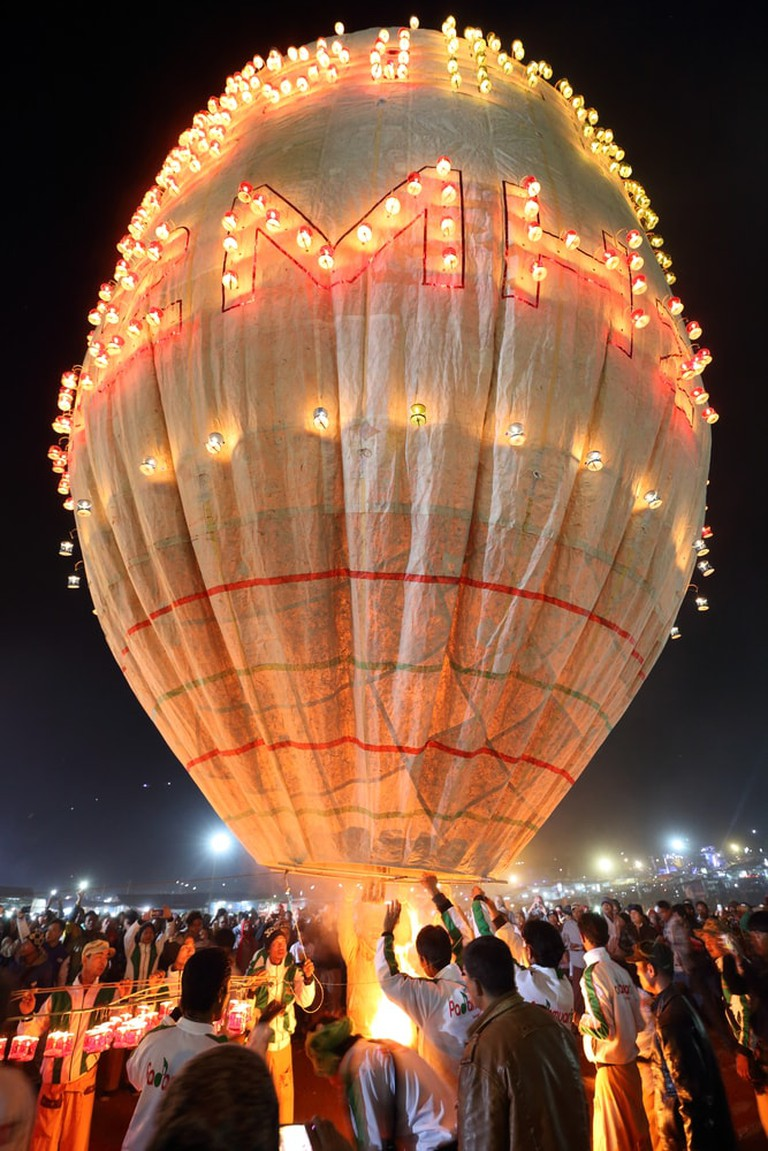 Buddhists prepare to release a hot air balloon at the Taunggyi Festival
