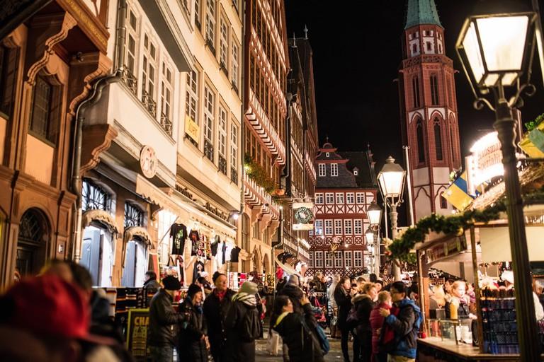 Visitors at a traditional Christmas market in Frankfurt, Germany | © J. Lekavicius/Shutterstock