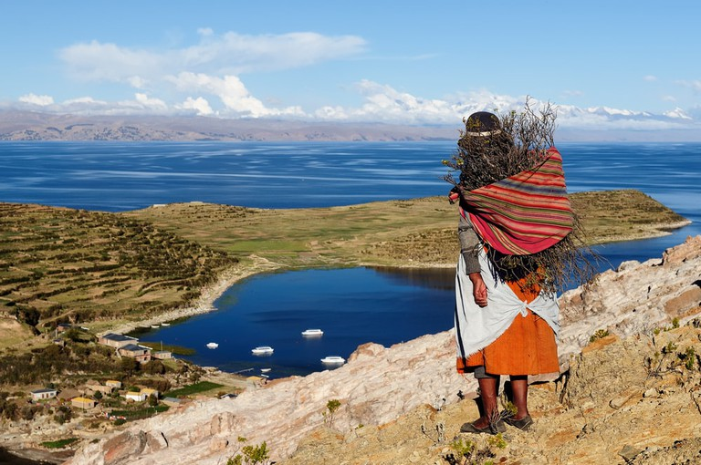 A native woman looks out over Lake Titicaca from Bolivia's Isla del Sol