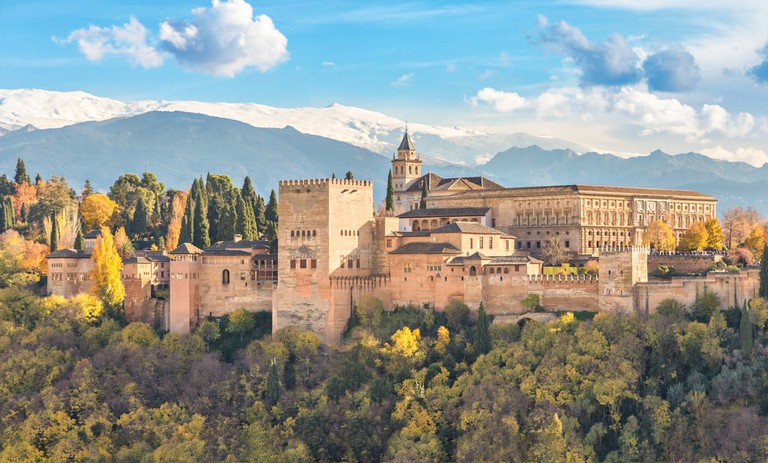Alhambra - medieval Moorish fortress surrounded by autumn trees, Granada, Spain | © Sergey Dzyuba/Shutterstock