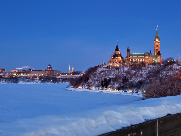 Ottawa's Parliament Buildings glowing in winter