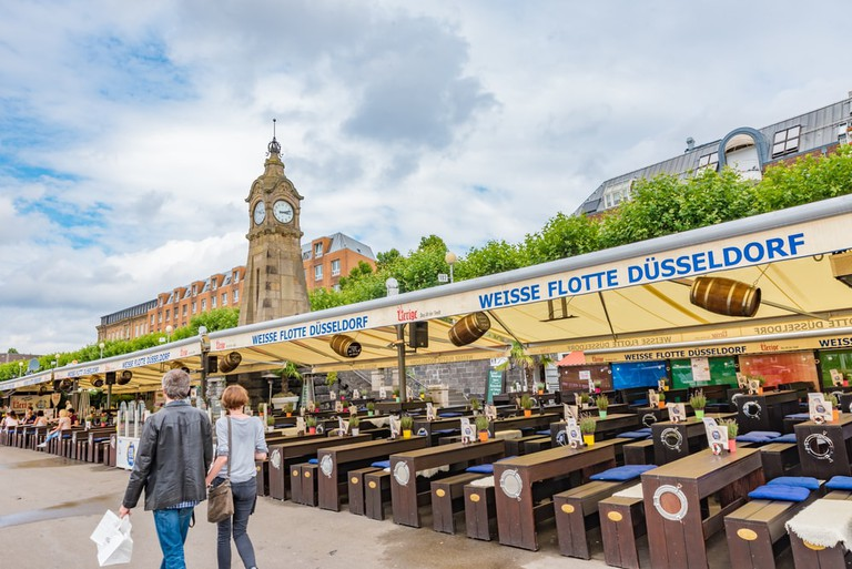 Rhine promenade with restaurants and bars in Dusseldorf, Germany   © Takashi Images/Shutterstock